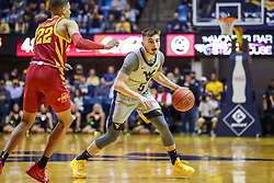Mar 6, 2019; Morgantown, WV, USA; West Virginia Mountaineers guard Jordan McCabe (5) dribbles during the second half against the Iowa State Cyclones at WVU Coliseum. Mandatory Credit: Ben Queen-USA TODAY Sports