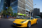 Expensive sports car passing the shopping malls and offices in Zhongguancun or Zhong Guan Cun, a technology hub in Haidian District, Beijing, China. It is situated in the northwestern part of Beijing city. Zhongguancun is very well known in China, and is often referred to as China's Silicon Valley. This is Beijing's computer district with numerous tech companies offices situated here amongst the many malls which sell electronics and electrons equipment of all kinds. The tech park started as a small office where two decades ago some students from a nearby university decided that computer equipment may be a thing of the future so set up a small company. It has expanded in this time to  cover many square kilometres.