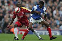Photo: Lee Earle.<br /> Portsmouth v Reading. The Barclays Premiership. 28/10/2006. Reading's Ibrahima Sonko (L) battles with Kanu.