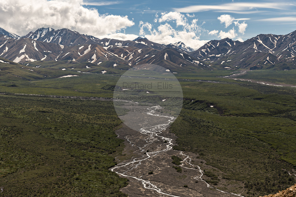 The braided Toklat River flows from the Polychrome Hills and the Alaska Range in Denali National Park Alaska. Denali National Park and Preserve encompasses 6 million acres of Alaska's interior wilderness.