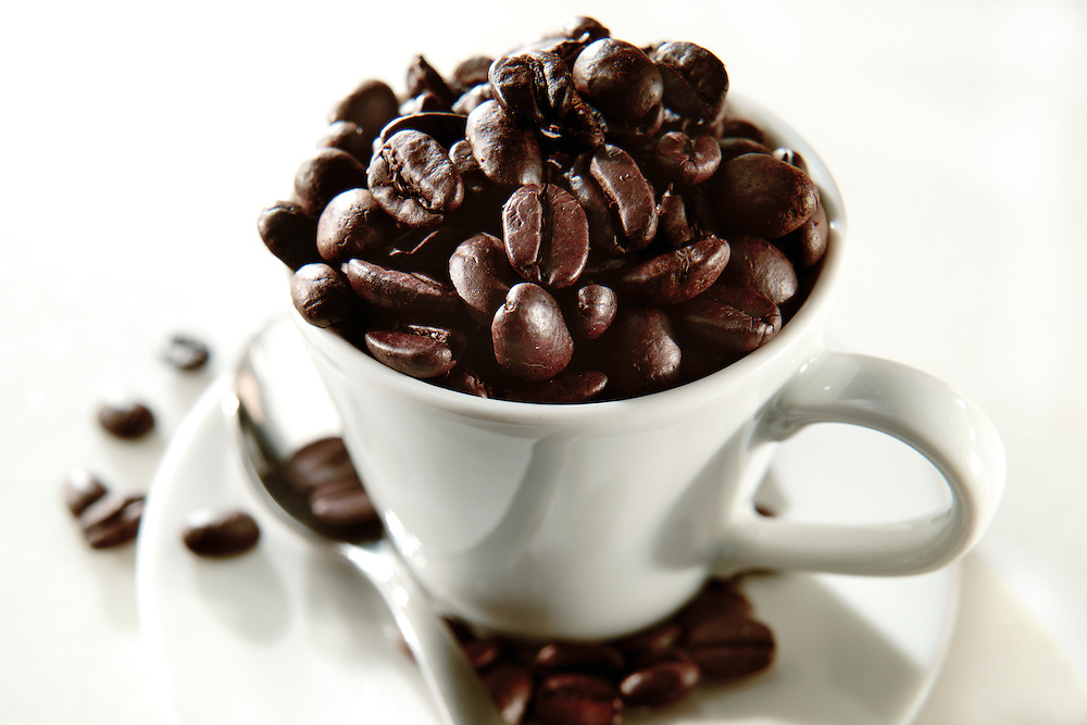 Fresh coffee beans in a coffee cup. Drink photos.