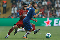 ISTANBUL, TURKEY - AUGUST 14: Joe Gomez (L) of Liverpool and Mateo Kovacic of Chelsea vie for the ball during the UEFA Super Cup match between Liverpool and Chelsea at Vodafone Park on August 14, 2019 in Istanbul, Turkey. (Photo by MB Media/Getty Images)