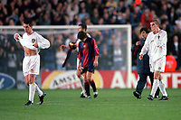 Ian Harte and Dominic Matteo (Leeds) walk off the pitch dejected after the game. Leeds United v Barcelona. European Champions League, Group H, 24/10/00. Credit: Colorsport / Andrew Cowie.