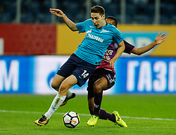 August 24, 2017 - Saint Petersburg, Russia - Daler Kuzyaev (L) of FC Zenit Saint Petersburg and Urby Emanuelson of FC Utrecht vie for the ball during the UEFA Europa League play-off round second leg match between FC Zenit St. Petersburg and FC Utrecht at Saint Petersburg Stadium on August 24, 2017 in Saint Petersburg, Russia. (Credit Image: © Mike Kireev/NurPhoto via ZUMA Press)