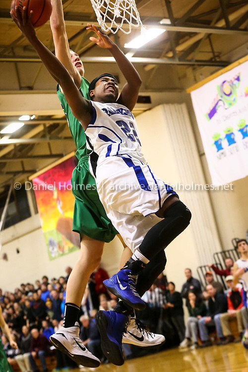 (1/5/15, HOPEDALE, MA) Hopedale's William Leke goes up and sinks one for two points during the boys basketball game against Sutton at Draper Gym in Hopedale on Monday. Daily News and Wicked Local Photo/Dan Holmes