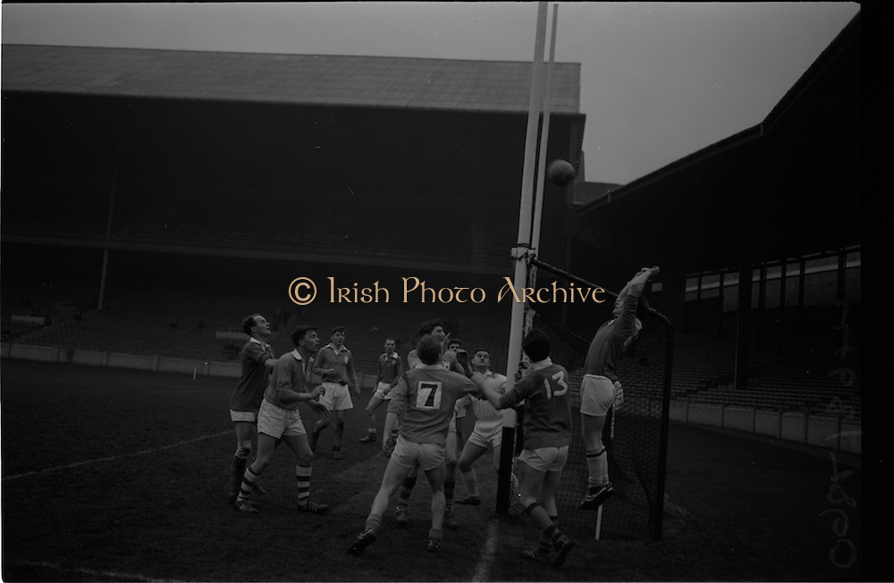21/02/1965<br /> 02/21/1965<br /> 21 February 1965<br /> Munster v Ulster Railway Cup semi-final at Croke Park. The final score was Ulster 0-14 Munster 0-9.<br /> All eyes on the ball as it crosses the bar for Munster's point.