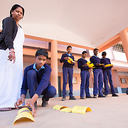 CAPTION: A trained ANM visits Bethany Convent School in Ratu, Ranchi, and teaches them on sexual and reproductive health through a game. The cards state the physical changes that occur for both boys and girls, and the boys are asked to segregate them by gender and put them in order. This is followed by a discussion. These sessions happen at the school biannually when the school health team visits. A lot more of this work is being done with girls as compared with boys. The reason is that for boys, suitable forums are not so readily accessible. For girls, there are the Mahila Samakhya schools and anganwadi centers. The latter come under the Government's Ministry of Women and Child Development. The School Health Program, however, is a component of the Adolescent Health Program, which gives importance to both boys and girls. Rashtriya Kishor Swasthya Karyakram (RKSK) (National Adolescent Health Program) was launched this year, doing peer interventions with both boys and girls. LOCATION: Bethany Convent School, Ratu (block), Ranchi (city), Jharkhand (state), India. INDIVIDUAL(S) PHOTOGRAPHED: From left to right: Raj Kumari Sinha, Nikhil Tigga, Subhash Gope, Kuldeep Sahu, Ritesh Munda and Raj Kumar Prajpati.