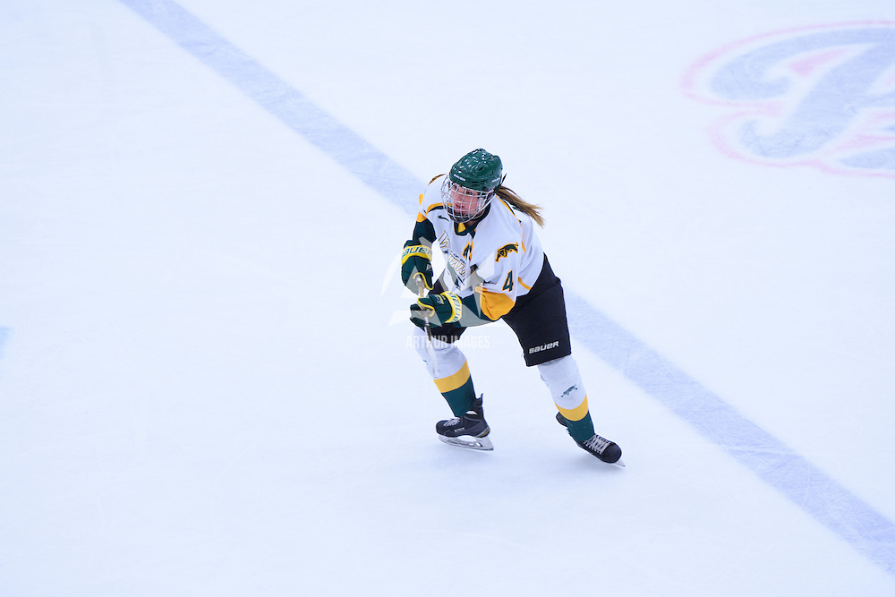 5th year defender Krista Metz (4) of the Regina Cougars in action during the Women's Hockey Home Game on November 26 at Co-operators arena. Credit: Arthur Ward/Arthur Images