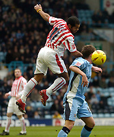 Photo. Glyn Thomas. 22/02/2005.<br /> Coventry City v Stoke City. Coca Cola Championship.<br /> Stoke's Kevin Harper (L) jumps higher than Stephen Hughes.