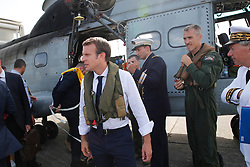 France's President Emmanuel Macron waits on the tarmac of Pointe-a-Pitre airport, Guadeloupe island, before boarding an helicopter en route to French Caribbean islands of St. Martin and St. Barthelemy, Tuesday, Sept. 12, 2017. Macron is heading to the French-Dutch island of St. Martin, where 10 people were killed on the French side and four on the Dutch, to meet with residents. (AP Photo/Christophe Ena, Pool)
