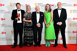 Sir David Attenborough (centre) and the Blue Planet 2 team with the award for Must see Moment in the press room at the Virgin TV British Academy Television Awards 2018 held at the Royal Festival Hall, Southbank Centre, London.