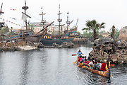 Visitors paddle a canoe through the Treasures Cove area at Walt Disney Co.s Shanghai Disneyland theme park  towards the iconic castle during a trial run ahead of its official opening, in Shanghai, China, on Wednesday, June 8, 2016. The $5.5 billion Shanghai Disneyland is one  of the most profitable Disney ventures in the world and the first theme park on mainland China.