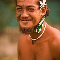Huahine, French Polynesia, Maeva, tatooed village male