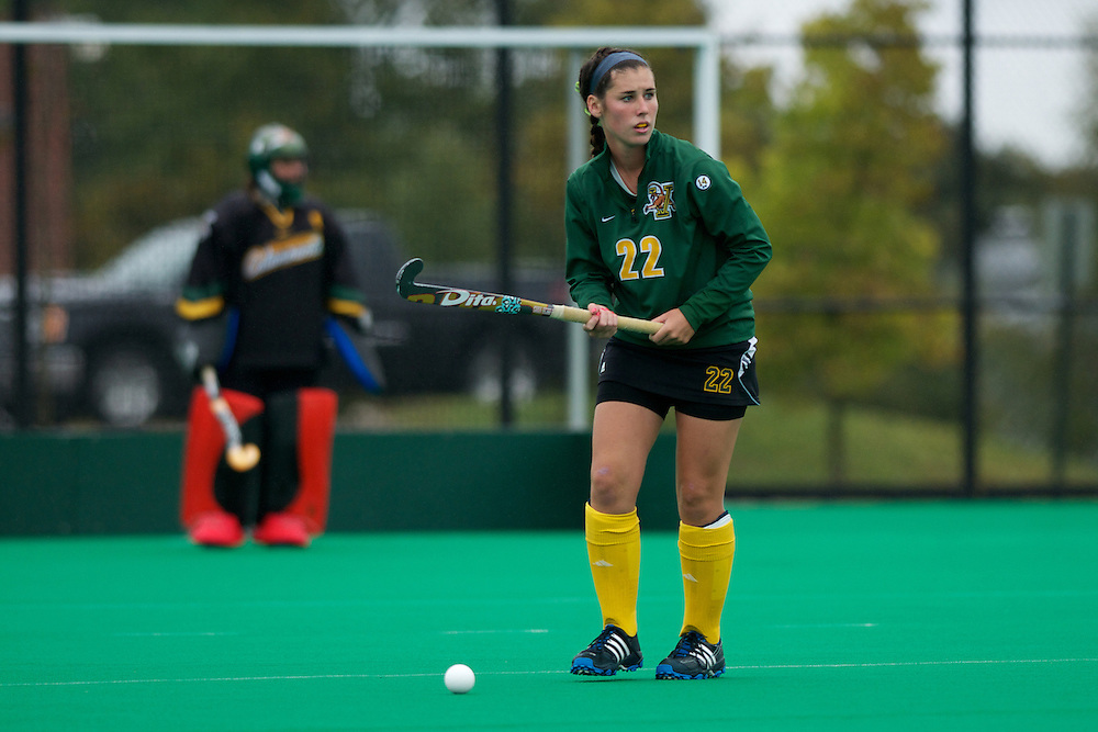 Catamounts midfielder Maddy Ostrander (22) looks to hit the ball down the field during the women's field hockey game between the Maine Black Bears and the Vermont Catamounts at Moulton/Winder Field on Saturday afternoon September 29, 2012 in Burlington, Vermont.
