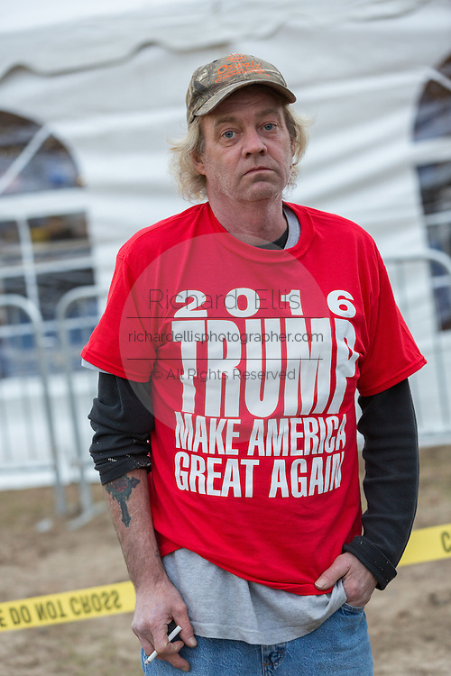 A Donald Trump supporters wearing a Make America Great Again tee shirt waits in line outside to see Billionaire and GOP presidential candidate Donald Trump at a rally January 27, 2016 in Lexington, South Carolina.