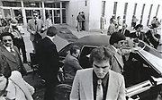Gavin DeBecker / Larry Flynt Trial After being shot in Georgia, Hustler Magazine publisher Larry Flynt - in wheelchair - stands trial in 1979 on obscenity charges in Atlanta. Security expert Gavin DeBecker - in suit and sunglasses at Flynt's side - leads a protective detail as Flynt arrives and departs court. de Becker - now in 2019 - security chief for Amazon's Jeff Bezos, leads a team of investigators probing the American Media - National Enquirer case alleging extortion of Bezos - the world's richest man.