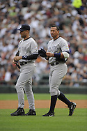 CHICAGO - AUGUST 1:  Alex Rodriguez #13 talks to Derek Jeter #2 (L) of the New York Yankees during the game against the Chicago White Sox on August 1, 2009 at U.S. Cellular Field in Chicago, Illinois.  The White Sox defeated the Yankees 10-5. (Photo by Ron Vesely)