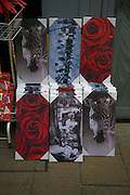 Canvas photo posters for sale on street stall