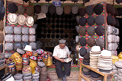 Many hats on display at hat shop in ancient city of Kashgar in Xinjiang Province in western China 2003