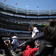 Japanese photographers photograph Masahiro Tanaka, New York Yankees, as he returns to the dugout during the New York Yankees V Chicago Cubs, double header game one at Yankee Stadium, The Bronx, New York. 16th April 2014. Photo Tim Clayton