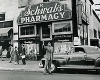 1945 Sidney Skolsky thumbs a ride in front to Schwab's Pharmacy