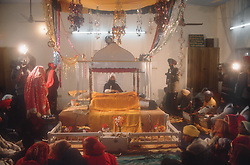 Bride; groom and guests being filmed at wedding ceremony in Patiala; Punjab; India,