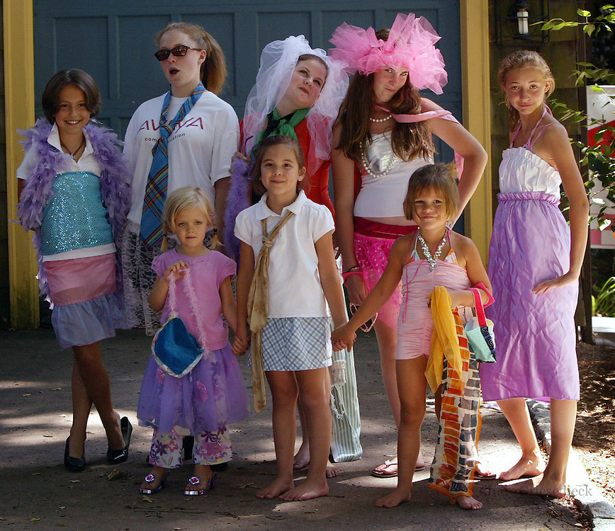 Neighborhood youngsters put on a fashion show for friends during a summer camp