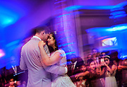 A bride and groom dance at their wedding reception held at Maplewood Country Club.