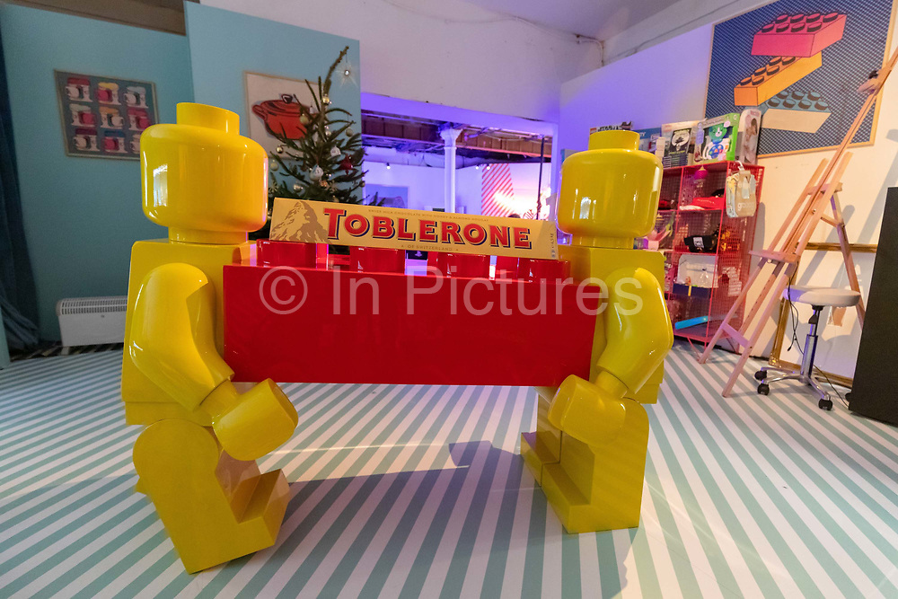A giant pair of Lego characters carrying a Toblerone inside the Amazon Black Friday pop-up shop in Shoreditch, east Lonon on November 23, 2018