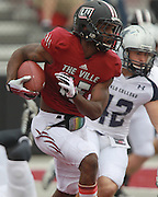 Lindenwood University - Belleville WR Harvey Binford (15, left) runs the ball during their Homecoming Game as Menlo College's Connor Martinez is on a collision course with him in the first half.  The Lindenwood Lynx team hosted the Menlo College Oaks.