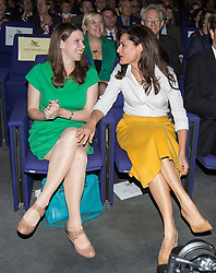 © Licensed to London News Pictures . 08/10/2014 . Glasgow , UK . Jo Swinson and Miriam Gonzalez Durantez sit beside one another ahead of Nick Clegg's keynote speech at the close of the conference . The Liberal Democrat Party Conference 2014 at the Scottish Exhibition and Conference Centre in Glasgow . Photo credit : Joel Goodman/LNP