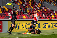Watford forward Joseph Hungbo (#7) is fouled by Brentford Defender Mads Bech Sorensen(#29) during the EFL Sky Bet Championship match between Brentford and Watford at Brentford Community Stadium, Brentford, England on 1 May 2021.