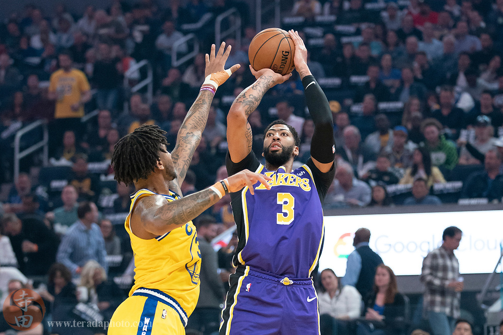 February 27, 2020; San Francisco, California, USA; Los Angeles Lakers forward Anthony Davis (3) shoots the basketball against Golden State Warriors forward Marquese Chriss (32) during the first quarter at Chase Center.