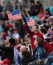 February 22, 2018 - Pyeongchang, South Korea - A young US hockey fan waves a flag before the start of overtime at the Women's Gold Medal Ice Hockey game Thursday, February 22, 2018 at Gangneung Hockey Centre at the Pyeongchang Winter Olympic Games. Photo by Mark Reis, ZUMA Press/The Gazette (Credit Image: © Mark Reis via ZUMA Wire)