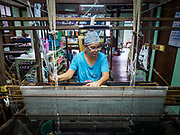 27 SEPTEMBER 2018 - BANGKOK, THAILAND:  in the Niphon Manuthas silk weaving shop in the Ban Krua neighborhood of Bangkok. This used to be the heart of the Thai silk industry but now most Thai silk is made in large commercial factories outside of Bangkok and there only two silk factories, employing fewer than 15 people, left in Ban Krua.    PHOTO BY JACK KURTZ