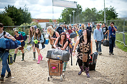 © London News Pictures. 23/08/2012. Reading, UK. Music Fans arriving at Reading Festival on August 23, 2012. The three day event which attracts over 80,000 music revellers  opens officially tomorrow (Friday) and will headline The Cure, Kasabian and The Foo Fighters. Photo credit: Ben Cawthra/LNP
