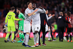 Manchester United's Romelu Lukaku (centre) and Nemanja Matic (left) celebrate victory after the Premier League match at the Vitality Stadium, Bournemouth.