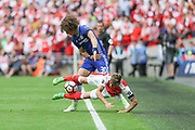Arsenal's Mesut Özil(11) is bundled over by Chelsea's David Luiz(30) during the The FA Cup final match between Arsenal and Chelsea at Wembley Stadium, London, England on 27 May 2017. Photo by Shane Healey.