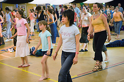 Group of women and children taking part in a Jazz CoTech street jazz dance workshop at the WOMAD (World of Music; Arts and Dance) Festival in reading; 2005,
