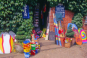 AJDMBF Colourful beach products outside a gift shop Walberswick Suffolk England