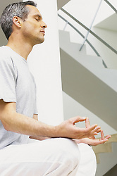 Jul. 26, 2012 - Man meditating (Credit Image: © Image Source/ZUMAPRESS.com)