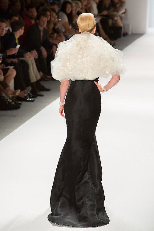 Black strapless gown with igh slit front and puffy organza and lace wrap. By Zang Toi, shown at his Spring 20132 Fashion Week show in New York.