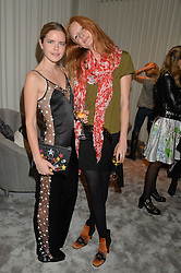 Left to right, KATIE READMAN and OLIVIA INGE at the Crisian London Boutique Opening at 41-42 Dover Street, London on 18th November 2014.