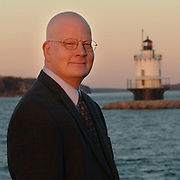 Mark Thompson, Executive Director of The Portland Harbor Museum, poses in front of Portland's Spring Point Light House. Photo by Roger S. Duncan