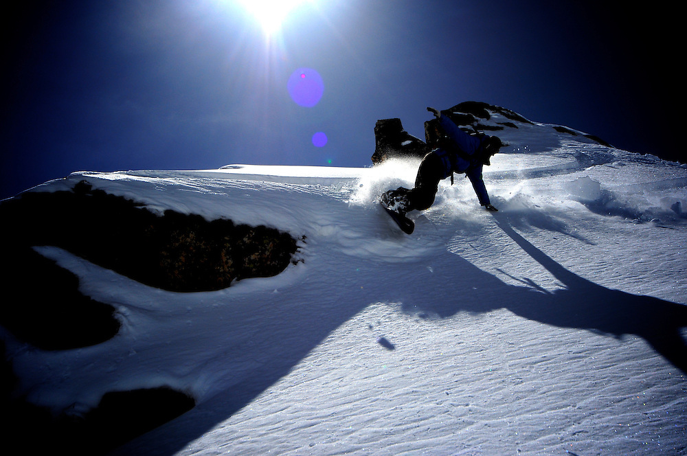 Silvain Boufflers engaging on a surf turn in the amazing spring powder of the magical Pyrenees backcountry terrain.