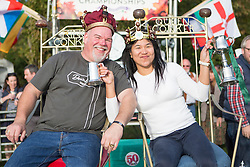 © Licensed to London News Pictures. 11/10/2015. Southwick, UK. Picture shows Steve Presscot & Amy Fero who are the new mens & ladies conker world champions. The 2015 Conker World Championships celebrates it's 50th year with competitors from around the world competing to become this years conker king. Photo credit: Andrew McCaren/LNP