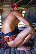 Mentawai indigenous man squatting (Indonesia).