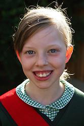 Portrait of girl in school uniform,