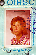 detail of identity document with photo of a red haired young boy 1970s