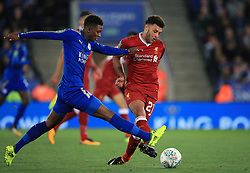 Leicester City's Demarai Gray (left) and Liverpool's Alex Oxlade-Chamberlain battle for the ball during the Carabao Cup, third round match at the King Power Stadium, Leicester.